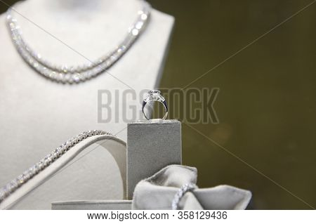 Ring With A Huge Diamond On The Background Of A Sparkling Diamond Necklace, Studded With Large Real