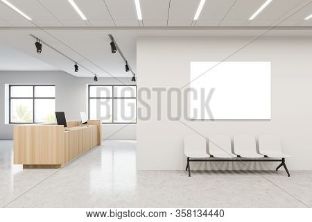 Interior Of Modern Hospital Hall With White Walls, Concrete Floor, Reception Desk With Computers And