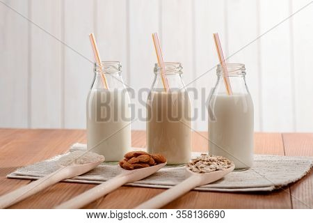Bottles Of Assorted Vegan Milk And Its Ingredients