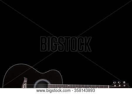 Black Guitar On Black Background With Copy Space