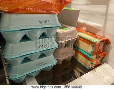 Woodbridge, New Jersey / Usa - March 28, 2020: Cheese And Eggs Are Stored In A Residential Refrigera