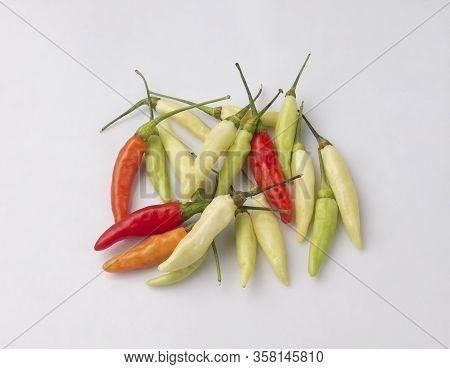 Colorful Of Chili Peppers Isolated On White Background