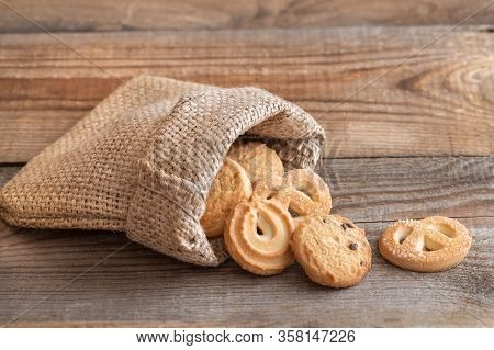 Butter Cookies In Burlap Bag On Wooden Table