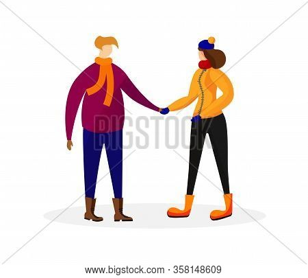 Young Man And Woman In Winter Clothing Holding Hands Isolated On White Background. Loving Couple Spe