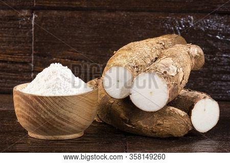 Raw Cassava Starch - Manihot Esculenta. Wood Background
