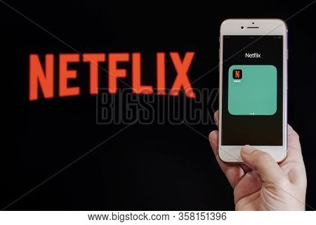 Thessaloniki, Greece - March 21 2020: Netflix Streaming Service Vod Content Provider Concept. Hand H