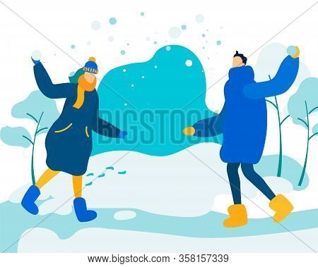 Young Loving Couple Playing Snowballs On Street. Winter Time Vacation, Fun, Happy Man And Woman Char