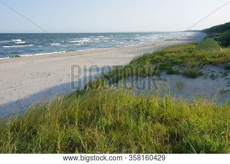Baltic Sea Coast, Small Waves On The Sea, Ships On The Sea Horizon