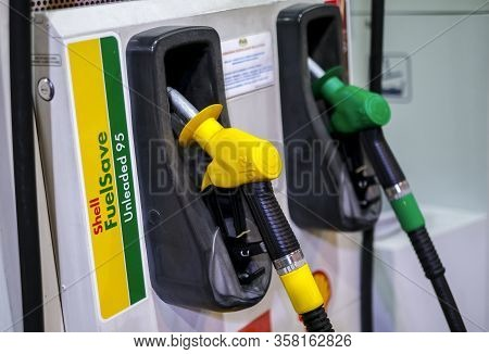 Petrol Pump Filling Nozzles At Shell Gas Station