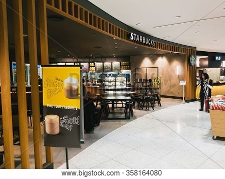 Athens, Greece - February, 11 2020: A Starbucks Coffee Cafe Inside The Departure Hall Of Athens Inte