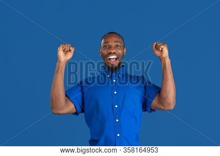 Crazy Happy Winner. Monochrome Portrait Of Young African-american Man Isolated On Blue Studio Backgr