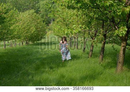 Slavic Woman In A Fruit Garden Close Up