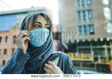 Coronavirus Pandemic In City. Woman In Hood Wearing Protection Face Mask For Prevention Coronavirus,