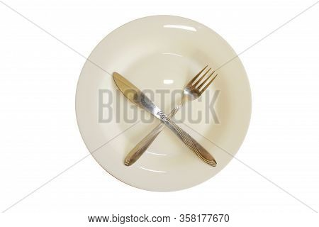 Close Up Of Knife And Fork On White Background. Empty Plate With Knife And Fork. Knife And Fork On W