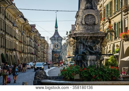 Bern, Switzerland - September 13, 2016: Street View Of Kramgasse With Fountain And Clock Tower In Th