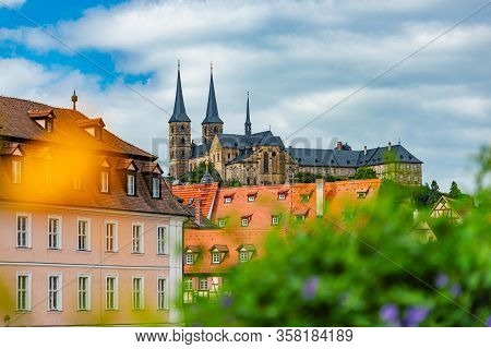 Bamberg City In Germany. Cathedral And Blue Cloudy Sky In Background. Architecture And Travel In Eur