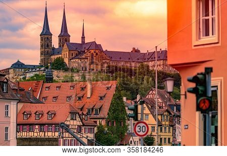 Bamberg City In Germany. Cathedral And Sunset Cloudy Sky In Background. Architecture And Travel In E
