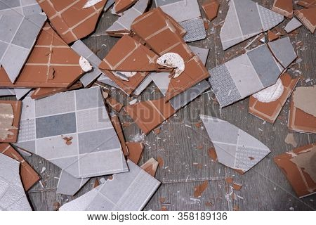 Pile of broken ceramic tiles remains after bathroom renovation prepared to be thrown into the trash Can be use as textured background
