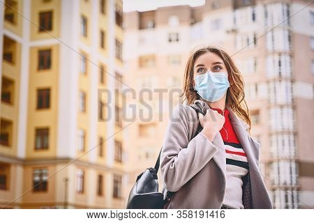 Young Woman With Beautiful Blue Eyes Wearing Protection Face Mask Against Coronavirus Mers-cov, Nove