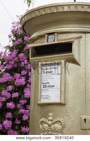 HAMBLE, NR SOUTHAMPTON, UK - AUG 8:UK's Royal Mail honors Gold Medal winners, by transforming a post box from red to gold in the home town of each gold medalist on Aug 8,2012 in Hamble, UK.