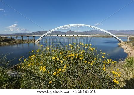 Roosevelt Lake Bridge White Metal Rainbow Arch Over Water