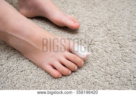 Kid Teenager Bare Foot With A Bandage On A Toe, Wounded Toe Or Ingrown Nail First Aid.