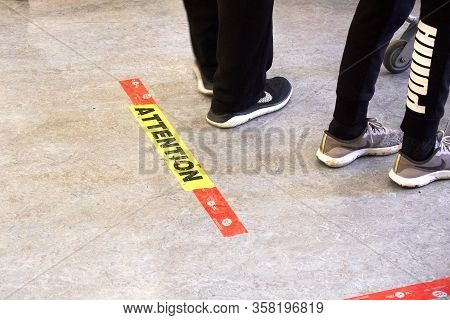 Montreal, Canada - March 28, 2020: Attention Line On Floor In Store To Keep Social Distancing. Socia