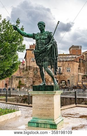 Rome, Italy. Bronze Statue Of Roman Emperor Augustus Caesar On Via Dei Fori Imperiali Street In The