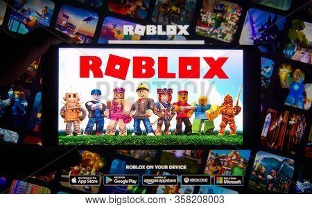 Montreal, Canada - March 22, 2020: Roblox Logo And App On A Mobile Screen In A Hand. Roblox Is A Mul