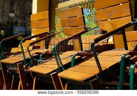 Bucharest, Romania - March 16, 2020: Chairs Tied In Chains Near A Closed Mexican Food Restaurant. In