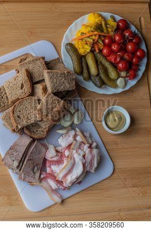 Bacon With Garlic. Rye Bread Bacon Garlic. Sliced Bacon, Garlic And Bread On A White Board. Salted V