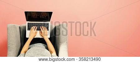 Woman Using A Laptop Computer Overhead View