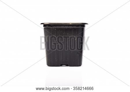 Used Black Plastic Gardening Bucket Waiting For Spring On White Background In Studio