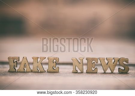 Fake News Wooden Letters On A Wooden Background. Fake News As A Form Of News Consisting Of Deliberat