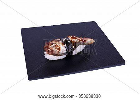 Traditional Fresh Japanese Sushi On Black Stone Nigiri Unagi On A White Background. Gunkan Ingredien