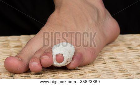 A Bandage Around A Sore Toe