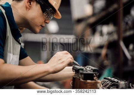 Professional Asian Worker Engineer Wearing A Yellow Helmet While Standing In A Heavy Industrial He L