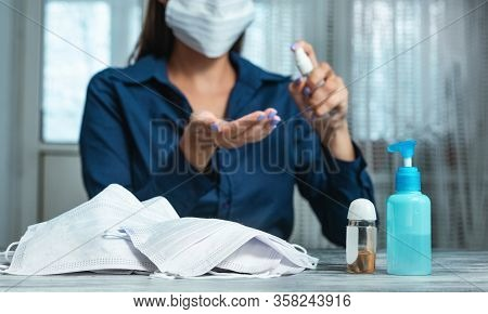 Preventive Measures Against Infection. Caucasian Woman Cleaning Her Hands With An Alcohol-based Hand