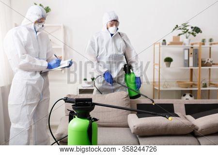 Anti Coronavirus Disinfection. Men In Hazmat Suits Cleaning Home, Epidemic, Quarantine