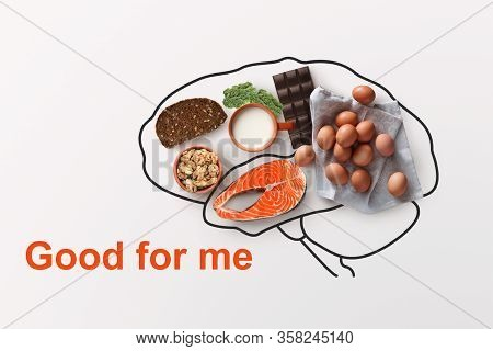Products To Boost Your Memory. Nutritious Foods And Outline Of Brains On White Background, Creative