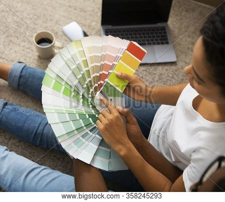 African American Girl And Men Holding Color Swatch, Chooses Tone For Interior, Cropped