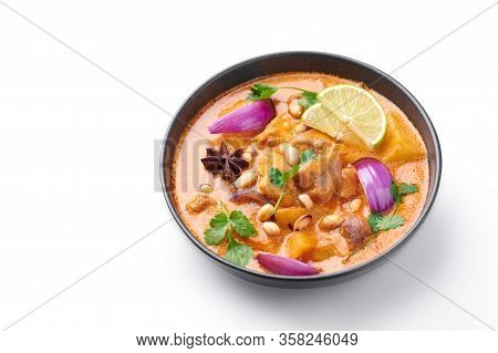 A Chicken Massaman Curry In Black Bowl Isoated On White Background. Massaman Curry Is Thai Cuisine D