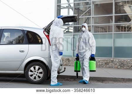 Stay At Home. Man In Hazmat Suits Buying Disinfection Spray For Home Cleaning, Epidemic, Quarantine,