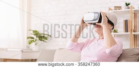 New Possibilities During Quarantine. Senior Woman Visiting Famous Museums In Vr Glasses At Home, Pan