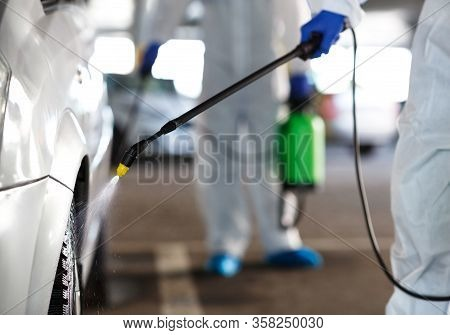 Unrecognizable Workers Washing Car With Chemicals, Coronavirus Concept, Covid 19, Epidemic
