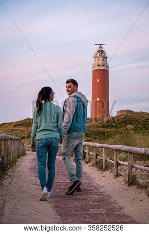 Texel Lighthouse During Sunset Netherlands Dutch Island Texel, Couple Visit The Lighthouse , Men And