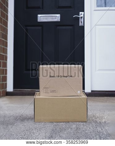 Parcel Cardboard Box In Front Door.door To Door Delivery Of Good Merchandises While The Quarantine,d