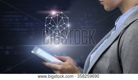 Biometric Verification Concept. Businesswoman Holding Mobile Phone With Face Made Of Polygonal Grid
