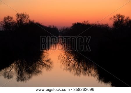 Beautiful Sunrise In The Camargue National Park. Rhone Delta, Provence, France, Mirror Reflection On