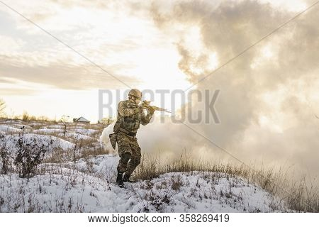 Army Man Running Through The Smoke And Explosions Sun Backlight And Smoke Background. Modern Warfare